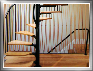 Classic Spiral stair construction combined  with oak treads create an elegant space saving piece.
